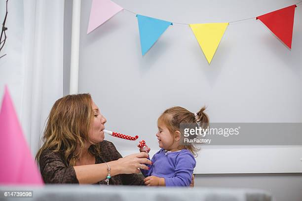 mother and her baby celebrating birthday - aunt stock pictures, royalty-free photos & images