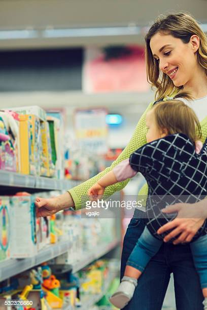 Mother And Her Baby Daughter In Local Supermarket.