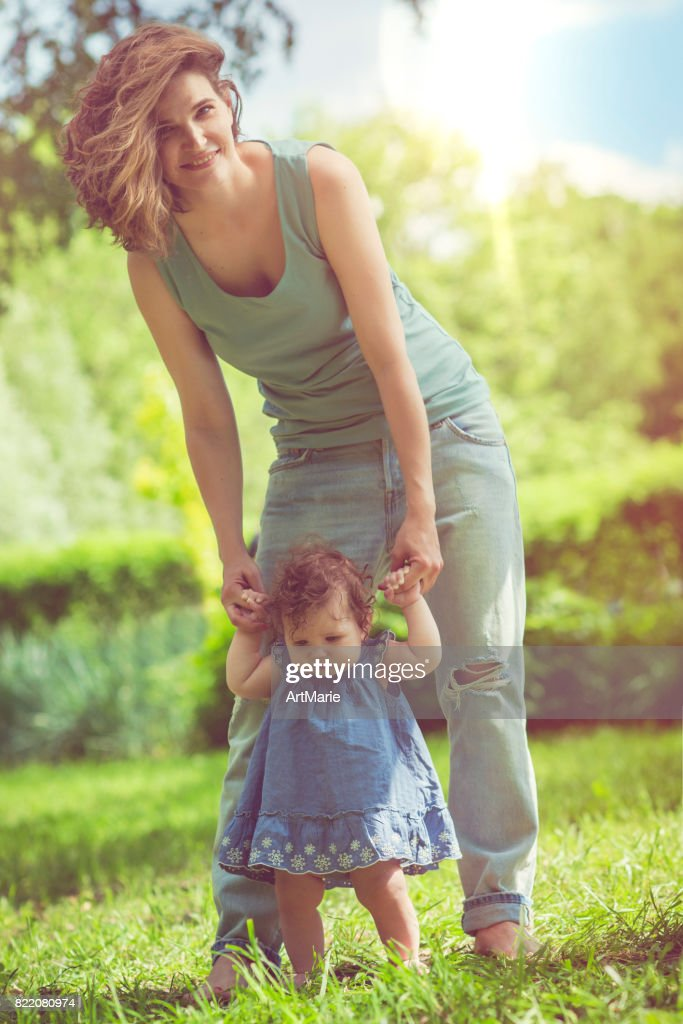 Mother and her baby daughter in park : Stock Photo
