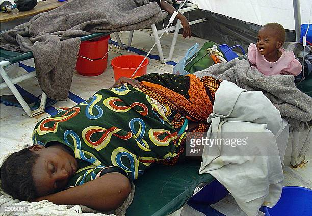 A mother and her child are pictured at the Matero Cholera centre 27 January 2004 in Lusaka A cholera epidemic in Zambia has claimed 50 lives and more...