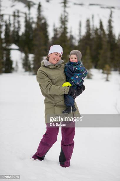 Mother and her child in winter landscape