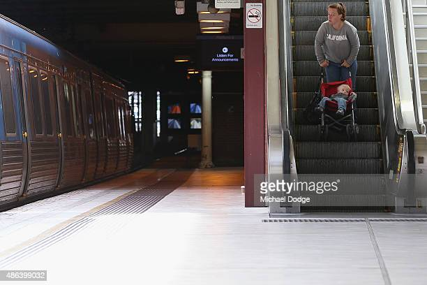 A mother and her child leave Flinders Street Station after Train Union workers start their strike on September 4 2015 in Melbourne Australia The...