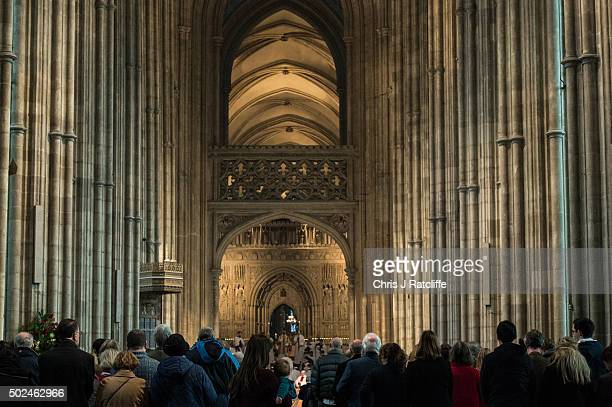 A mother and her child look on as the Archbishop of Canterbury Justin Welby holds communion and delivers his Christmas Day sermon to the congregation...