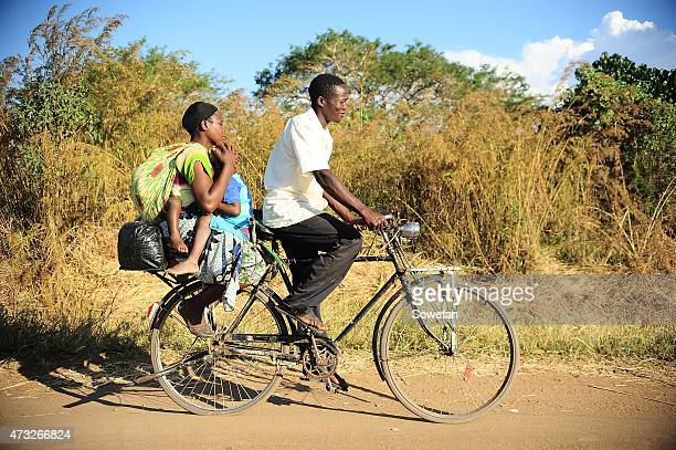 A mother and her children are passegers on a bicycle taxi on May 7 2015 in Malawi Bicycle taxis known as kabazas in Chichewa are a cheaper form of...