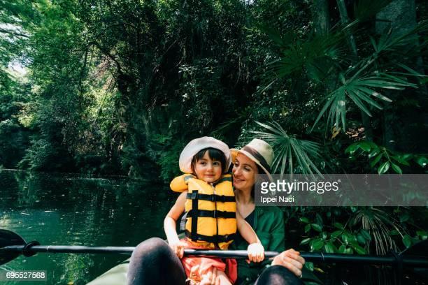 mother and her cute toddler girl kayaking together, saitama, japan - life jacket photos fotografías e imágenes de stock