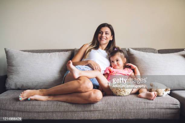 mother and her daughter having fun at home. - innocence stock pictures, royalty-free photos & images