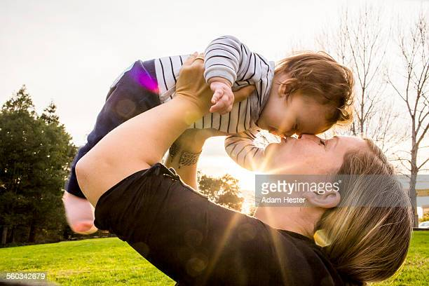 A mother and her daughter outside in park together