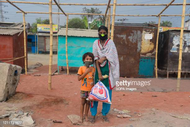 Mother and her daughter return back to their homes after receiving relief supplies. During the Coronavirus crisis besides the government, many...