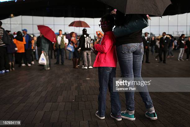 A mother and her daughter stand in front of the new Barclays Center on opening night which was to feature recording artist JayZ a part owner of the...