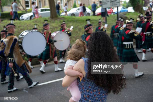 A mother and her daughter watch the parade together as the soldiers and cadets march onwards during the event Stirling shows its support of the UK...