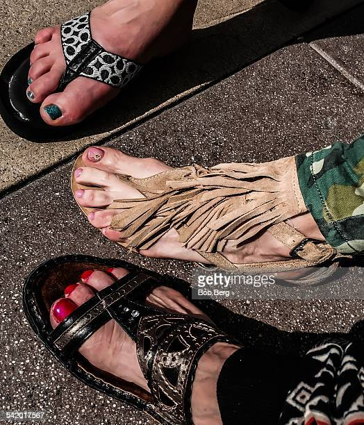Mother and her daughters put their best nail art feet forward.
