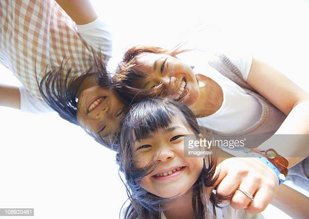 Mother and her daughters smiling