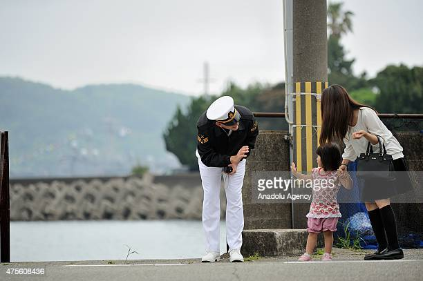 A mother and her daugther resident of Kushimoto city talk with a Turkish sailor of the Turkish navy frigate TCG GEDIZ arrived in Kushimoto for the...