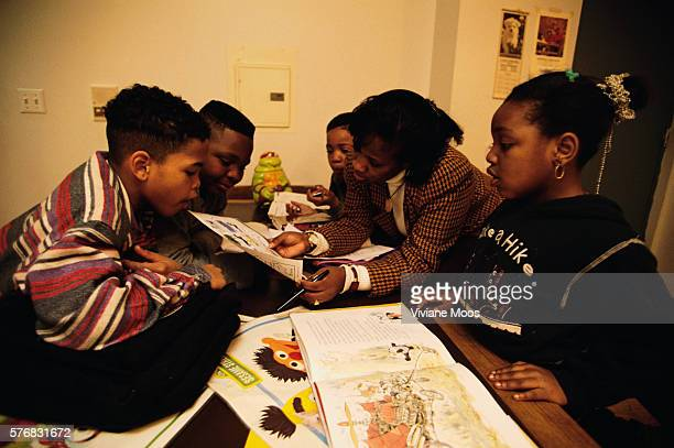 A mother and her four children read books at the Lydia E Hoffman Family Residence in the Bronx New York The charity was founded as a temporary...