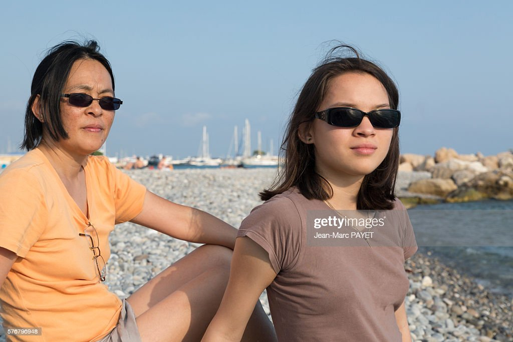 A mother and her girl on the beach : Stock Photo