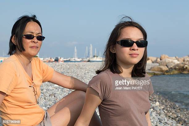 A mother and her girl on the beach