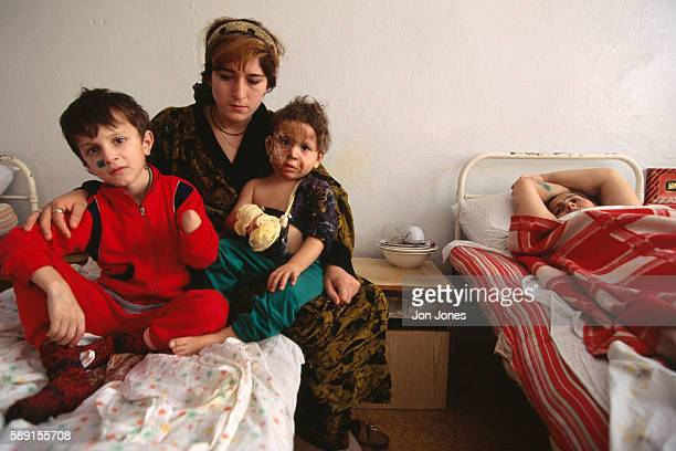 A mother and her injured children