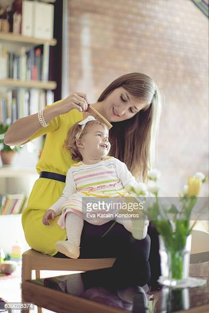 Mother and her little daughter at home