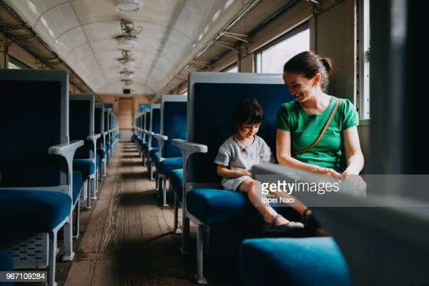 Mother and her little girl enjoying train ride