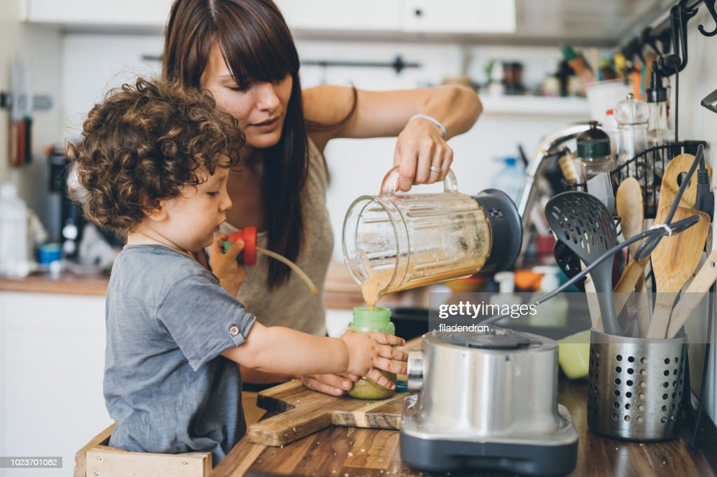 Mother and her little son preparing healthy smoothie : Stock Photo