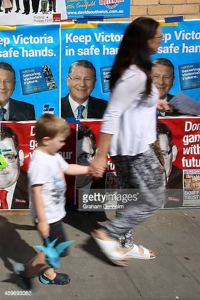A mother and her son arrive at the Caulfield District voting centre to vote in the Victorian State Election on November 29 2014 in Melbourne Australia