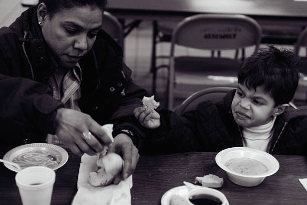 mother and child eating at soup kitchen in new york pictures getty