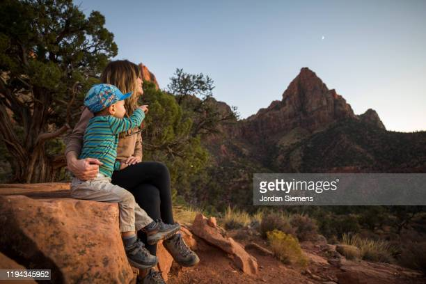 a mother and her son hiking a scenic trail. - st. george utah stock pictures, royalty-free photos & images