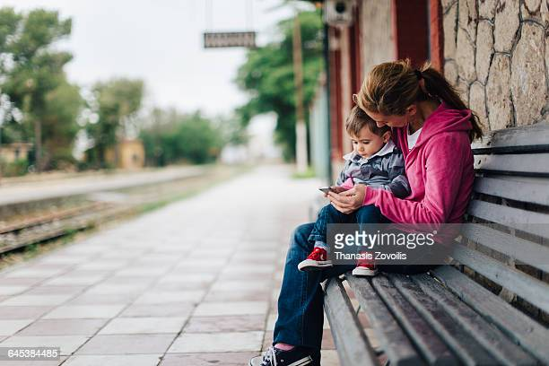 Mother and her son looking a smartphone