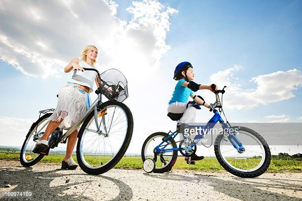 Mother and her son riding a bike.