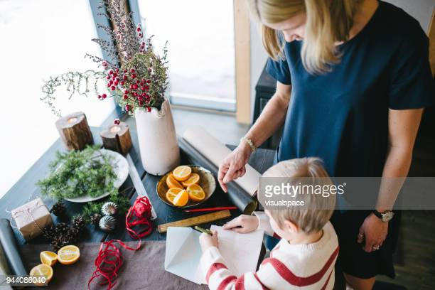 Mother and her son writing a letter ta Santa Claus