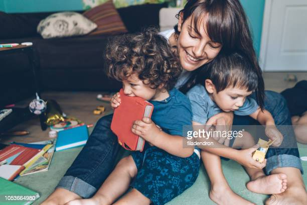 mother and her sons - chaos stock pictures, royalty-free photos & images