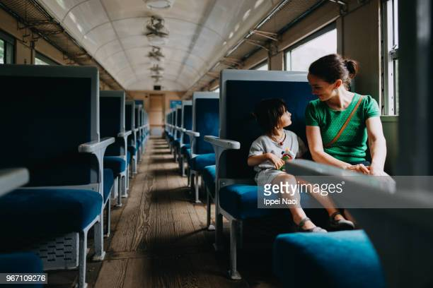 Mother and her toddler girl enjoying train ride