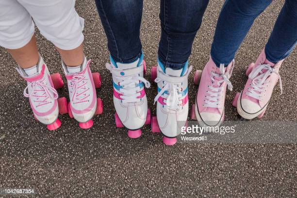 mother and her two daughters on roller skates, partial view - inline skate stock photos and pictures