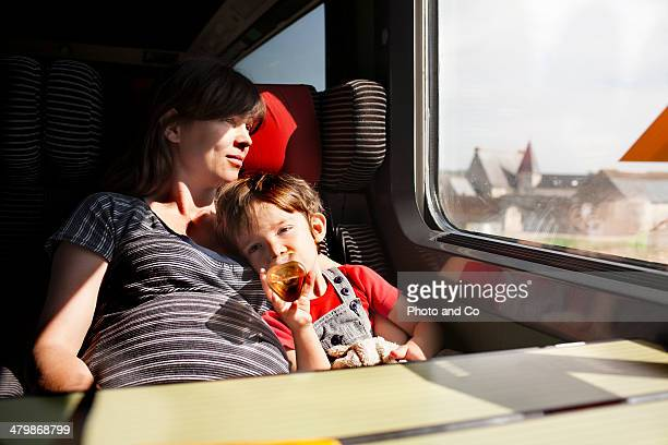 Mother and her young son in train