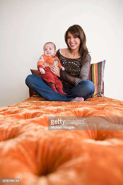 Mother and Infant Daughter on Chaise Lounge