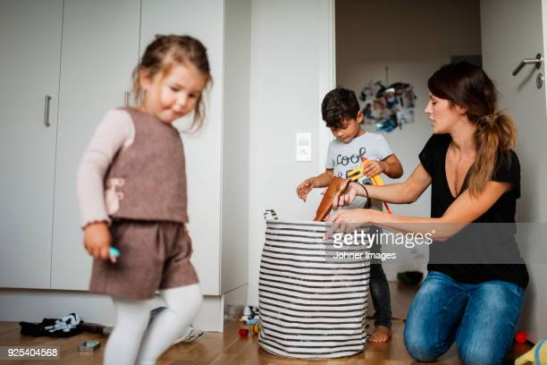 Mother and kids cleaning house