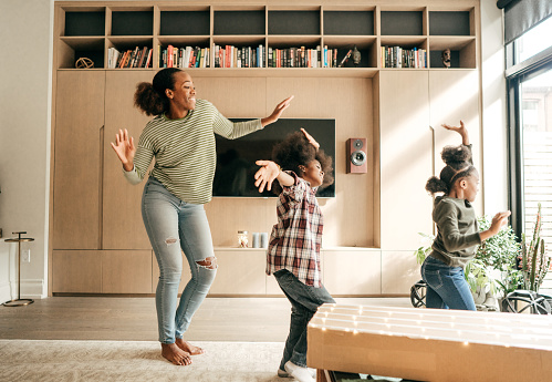 Mother and kids dancing 1080443848