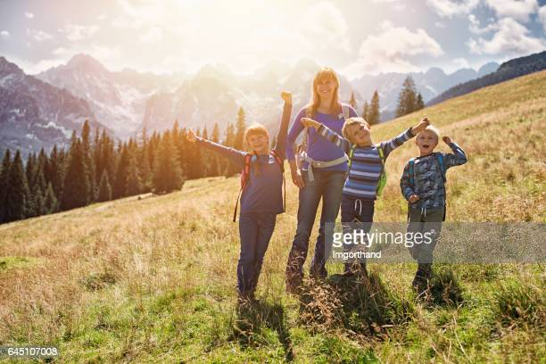 Mother and kids hiking in the mountains