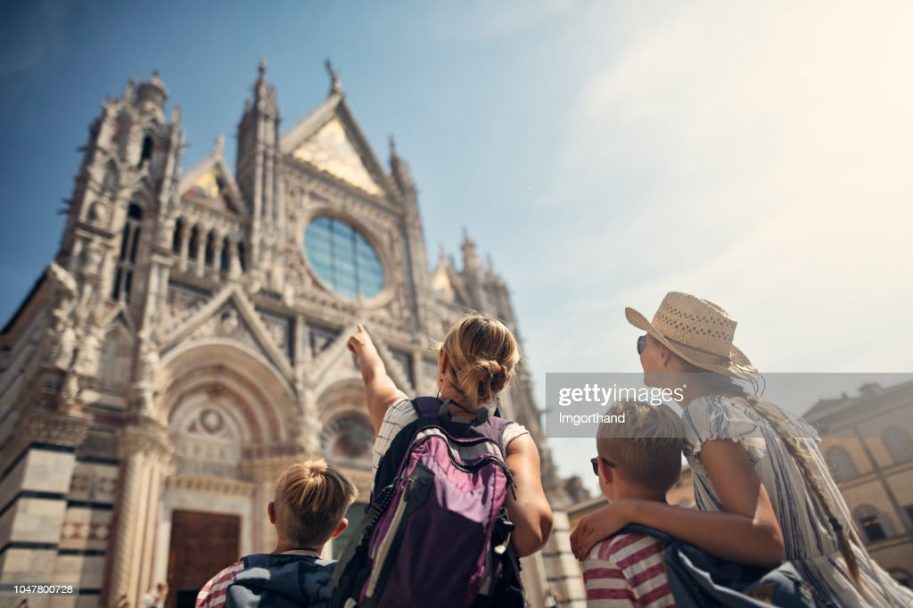 Mother and kids sightseeing city of Siena, Tuscany, Italy : Stock Photo