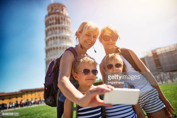 mother and kids taking selfie in pisa - pisa stock pictures, royalty-free photos & images