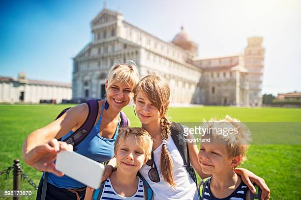 mother and kids tourists taking selfie in pisa - pisa stock pictures, royalty-free photos & images