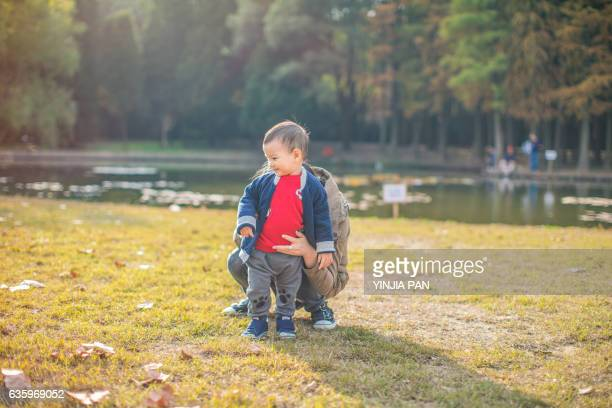 Mother and little boy in the park
