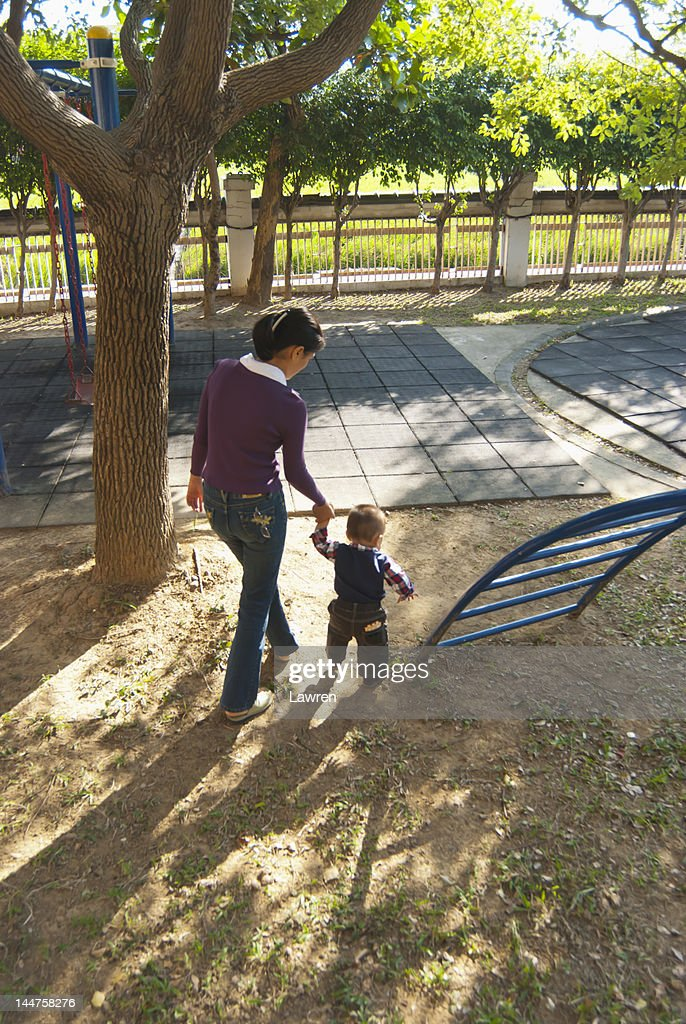 Mother and little boy playing in playground : Stock Photo