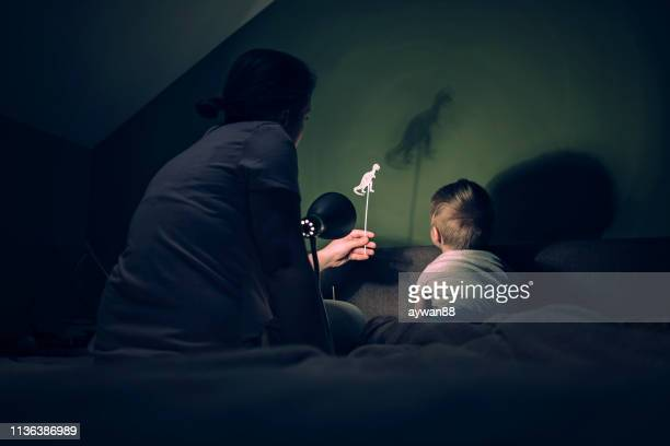 mother and little boy playing with shadows - puppet stock pictures, royalty-free photos & images
