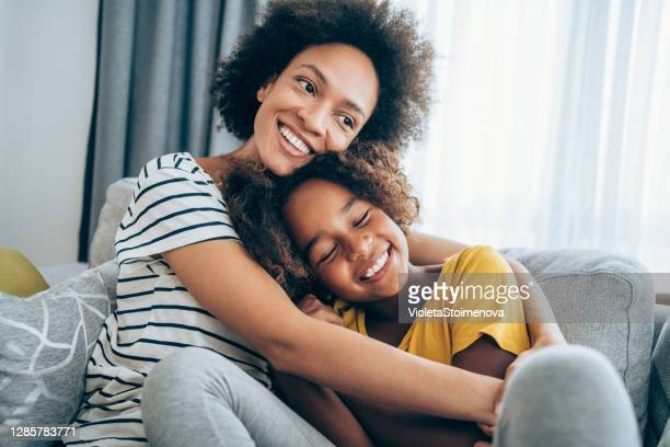 mother and little daughter at home. - mother stock pictures, royalty-free photos & images