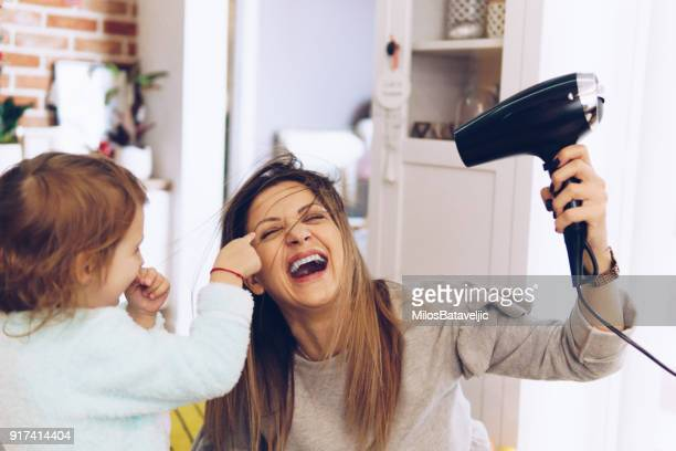 Mother and little daughter have fun