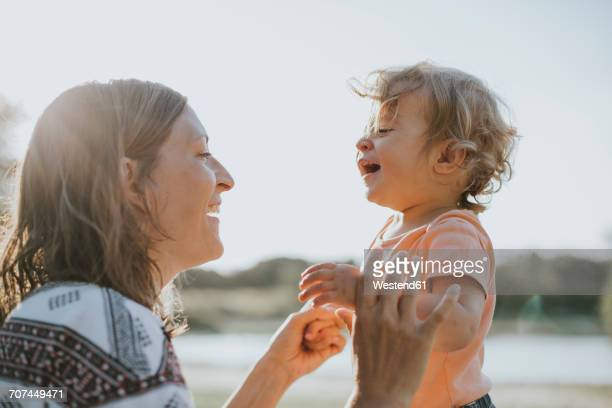 Mother and little daughter singing together