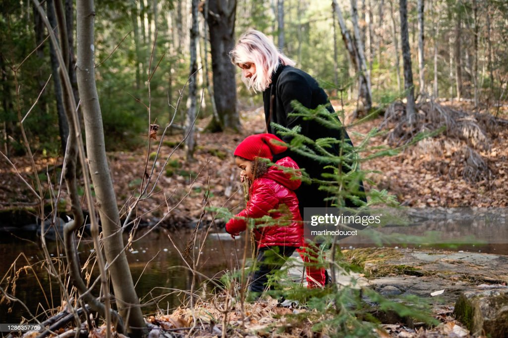 Mother and little daughter walking in the woods in autumn. : Stock Photo