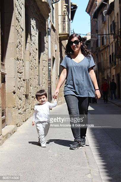 Mother and little daughter walking through the streets of Olite