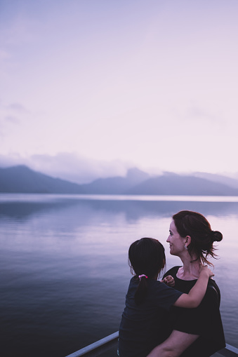 Mother and little girl enjoying view together at sunset, Nikko - gettyimageskorea